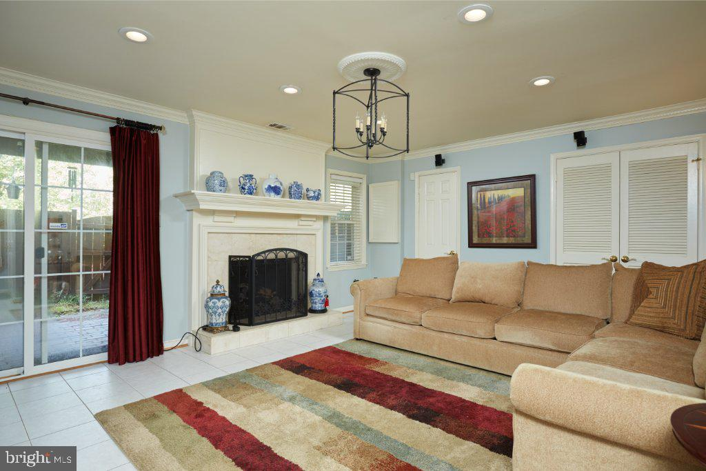 LL FR with stone covered  fireplace with mantel - 2028 GALLOWS TREE CT, VIENNA