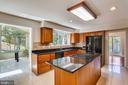 Kitchen, sunroom, dining room- all in one place - 7404 BRADLEY BLVD, BETHESDA