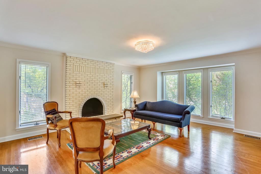 Sunlit formal living room with wood burning FP - 7404 BRADLEY BLVD, BETHESDA