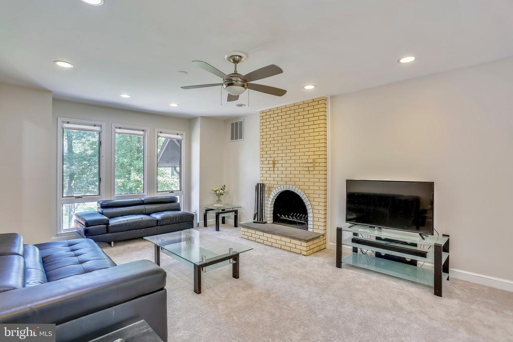 Family room with new carpet and wood burning FP - 7404 BRADLEY BLVD, BETHESDA