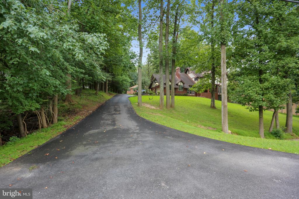 Long driveway to stately home - 7404 BRADLEY BLVD, BETHESDA