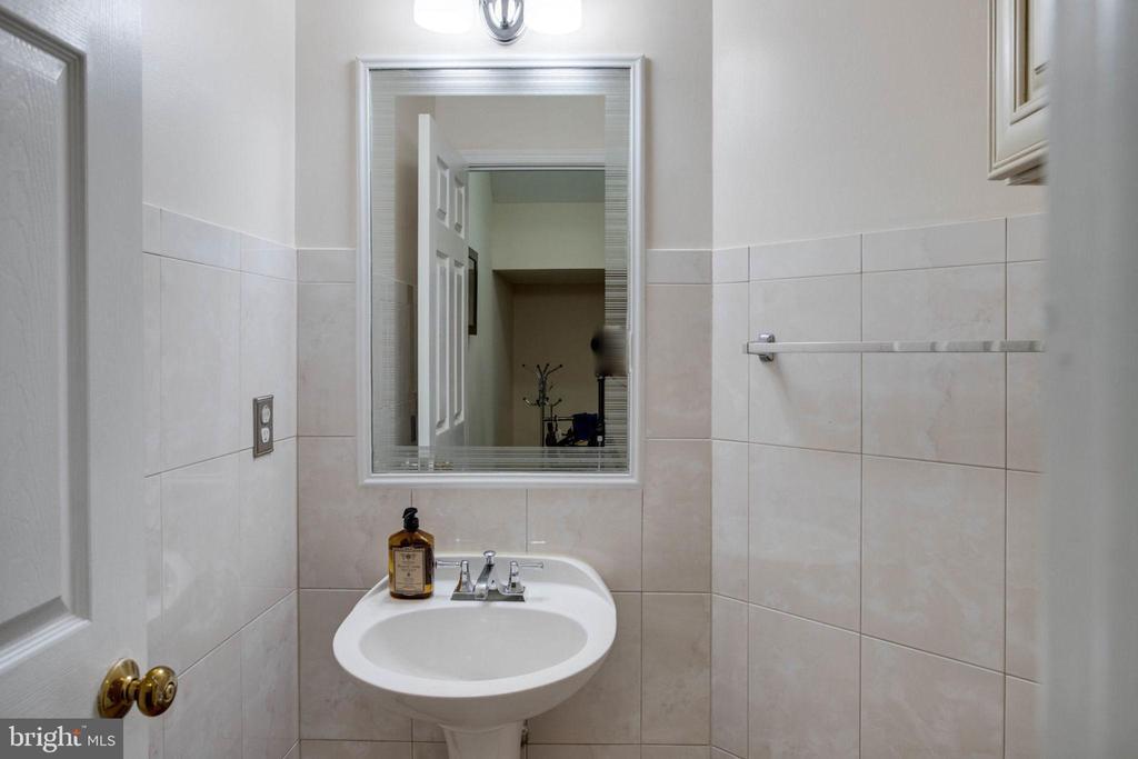Guest powder room w/modern over sized tiles - 4026 ROSEMEADE DR, FAIRFAX