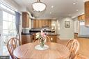 Kitchen boasts plenty of space for informal dining - 42956 OHARA CT, ASHBURN
