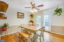 Dining room with French doors leading to deck - 1037 HARBOUR DR, STAFFORD