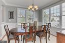 Dining Rm w/ Custom Trim Detailing + Windows - 23008 WHITE IBIS DR, BRAMBLETON