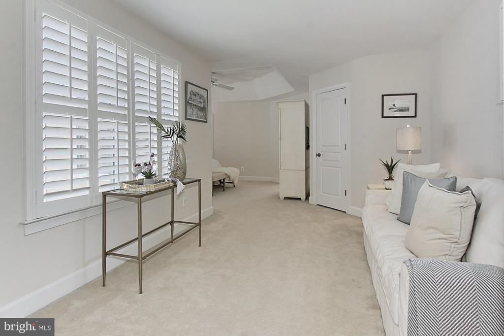 Sitting Area, graced w/ Plantation Shutter - 23008 WHITE IBIS DR, BRAMBLETON