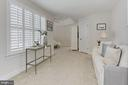 Sitting Area, graced w/ Plantation Shutter - 23008 WHITE IBIS DR, BRAMBLETON