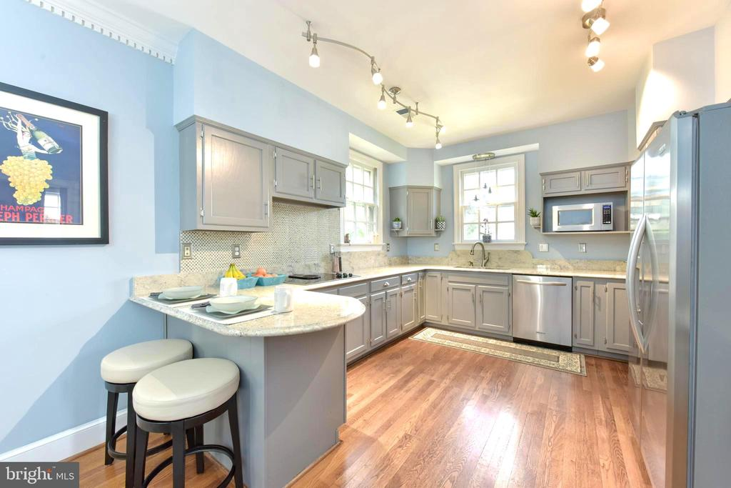 Serene grays and blues in this welcoming kitchen. - 1904 BELLE HAVEN RD, ALEXANDRIA