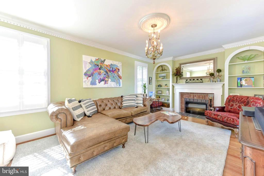 Large windows, fireplace and arched bookshelves. - 1904 BELLE HAVEN RD, ALEXANDRIA