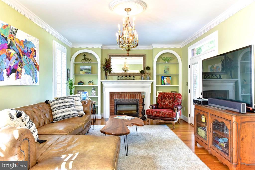 Symmetrical bookshelves flank fireplace. - 1904 BELLE HAVEN RD, ALEXANDRIA