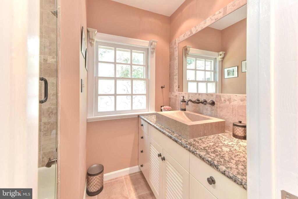 Hall Bathroom has granite and stone sink. - 1904 BELLE HAVEN RD, ALEXANDRIA