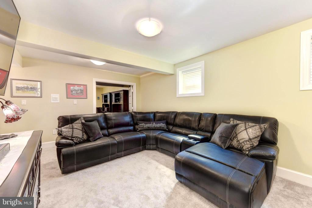 Leather sectional conveys; awesome TV room! - 1904 BELLE HAVEN RD, ALEXANDRIA