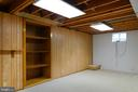 Rec room in basement with built-ins and new carpet - 403 CARDINAL GLEN CIR, STERLING