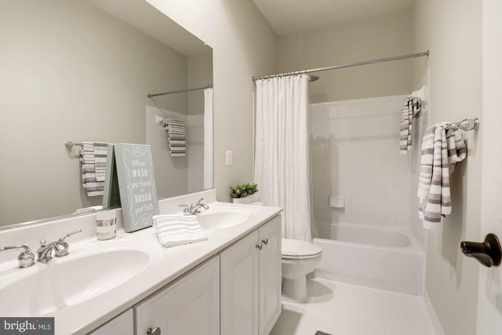 Full hall guest bath offers a dual sink vanity - 11691 CARIS GLENNE DR, HERNDON