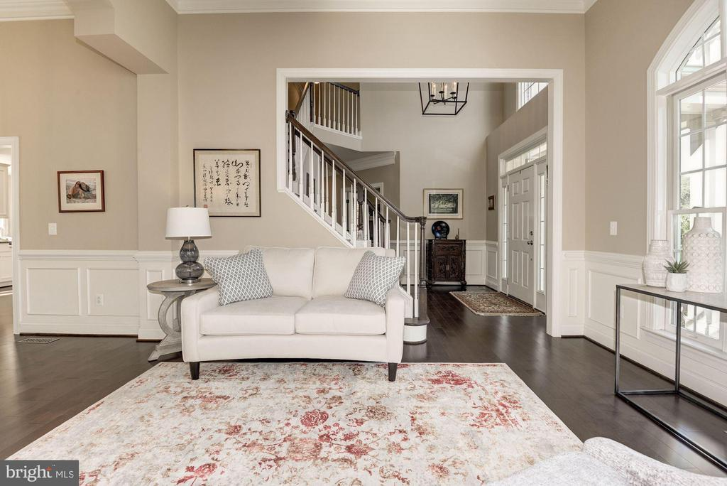View of Living room w/ foyer beyond - 11691 CARIS GLENNE DR, HERNDON