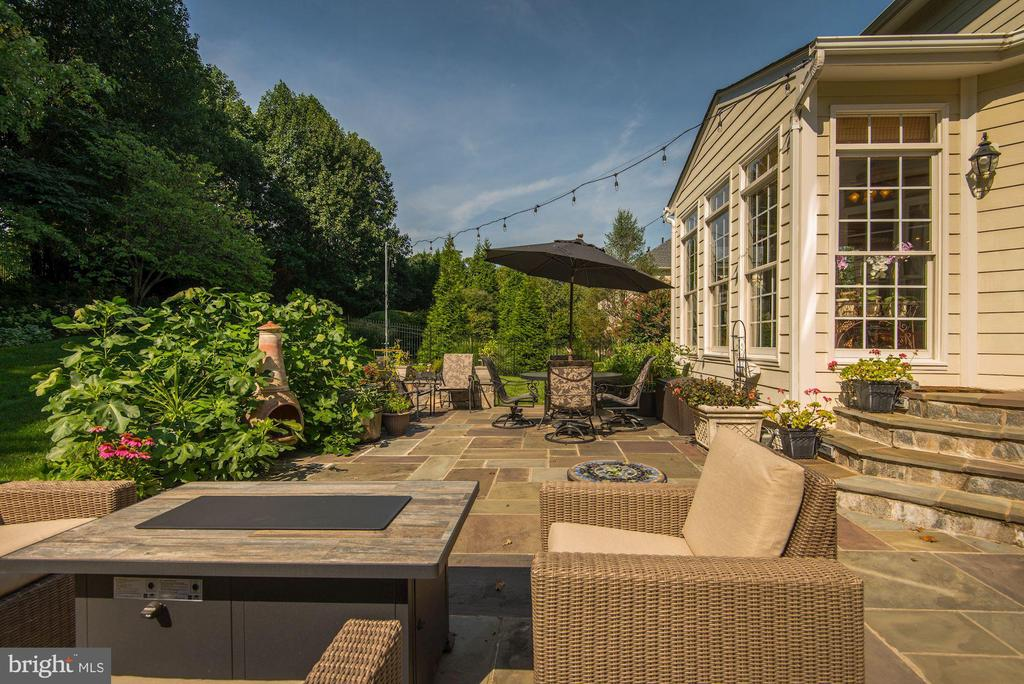 Slate patio just off the sunroom ... - 11691 CARIS GLENNE DR, HERNDON