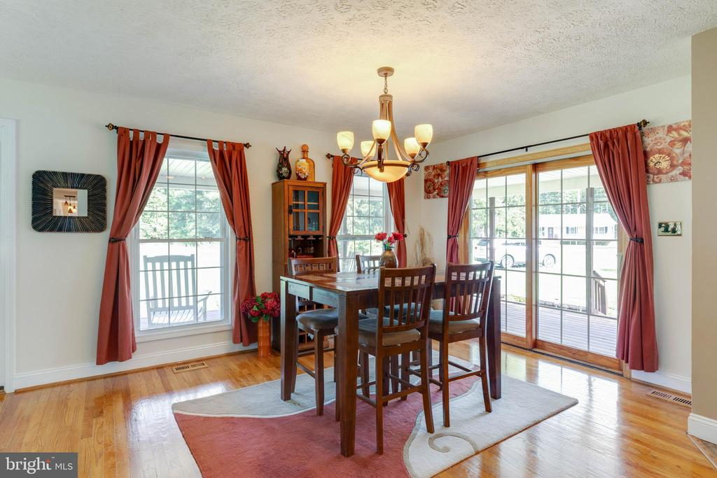Lovely dining area with SGD to 950 sq ft porch - 144 AQUA LN, COLONIAL BEACH