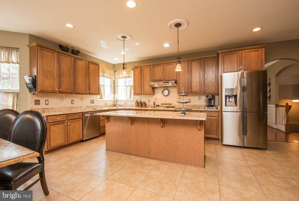 Stainless steal appliances. - 23084 RED ADMIRAL PL, BRAMBLETON