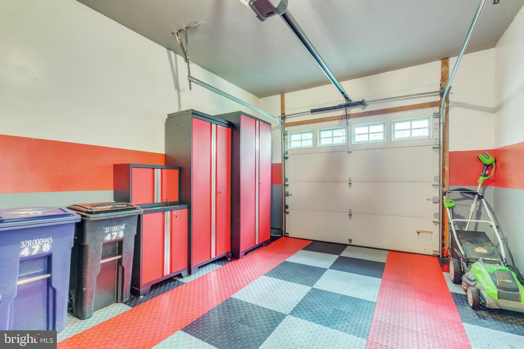 1-car garage with upgraded flooring & storage - 478 FOXRIDGE DR SW, LEESBURG