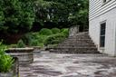 Stone patio steps from side yard - 11624 CEDAR CHASE RD, HERNDON