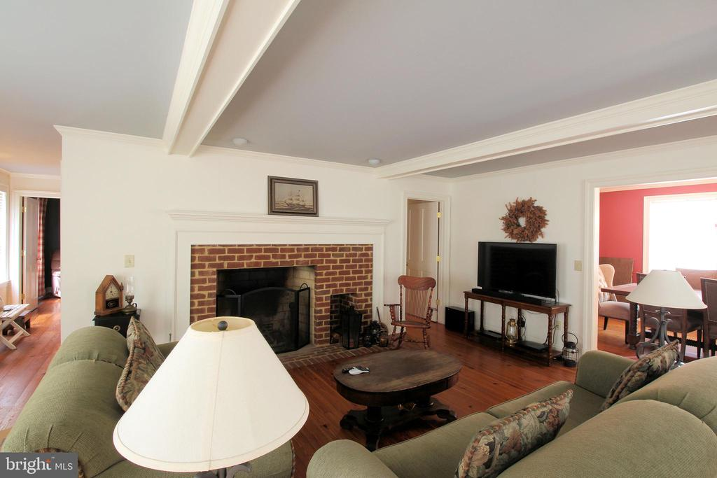 Custom Fireplace and Overhead Beams Add Charm - 1208 SPOTSWOOD DR, LOCUST GROVE