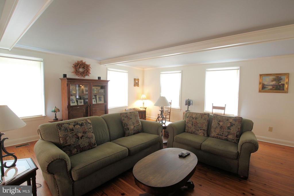 Warm and Inviting Living Room / Heart Pine Floors - 1208 SPOTSWOOD DR, LOCUST GROVE