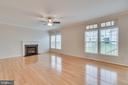 Family room with gas fireplace - 9341 BIRCH CLIFF DR, FREDERICKSBURG