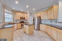 Kitchen with granite countertops - 9341 BIRCH CLIFF DR, FREDERICKSBURG