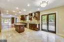 Kitchen has stone flooring & Kraftmaid cabinets - 12001 SUGARLAND VALLEY DR, HERNDON