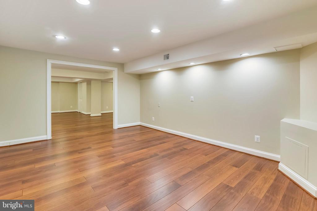 Beautiful flooring in rec room and media area - 12001 SUGARLAND VALLEY DR, HERNDON
