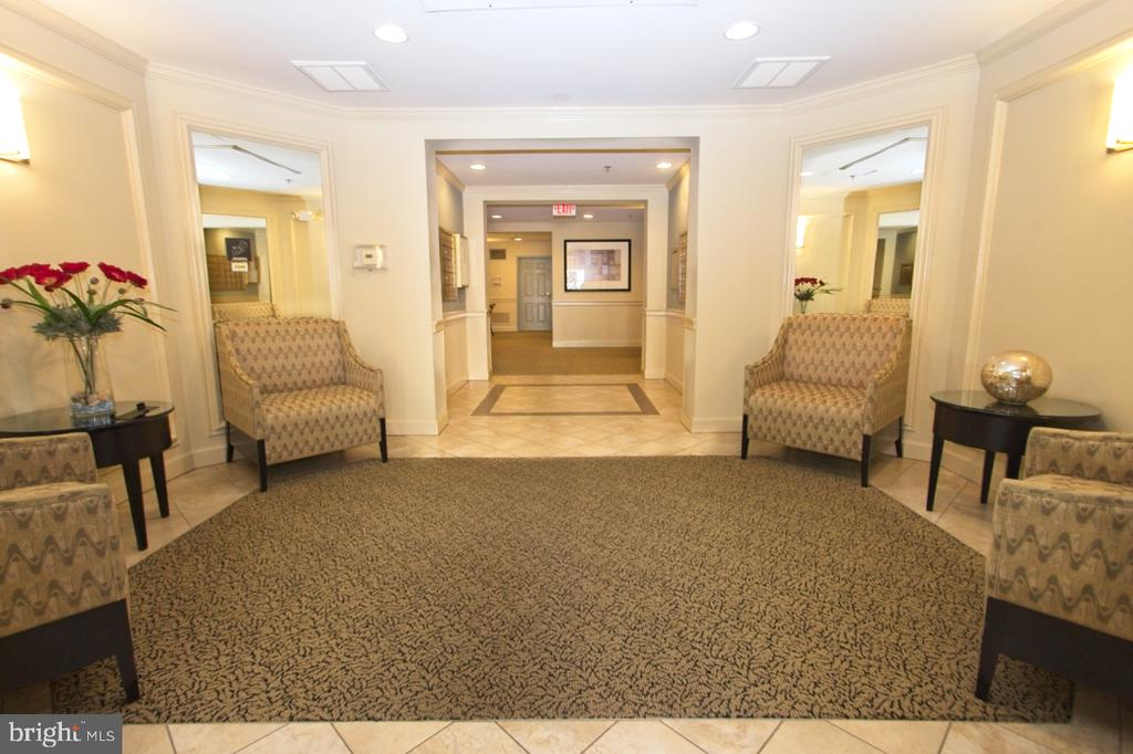 A beautifully appointed lobby entrance - 1855 STRATFORD PARK PL #309, RESTON