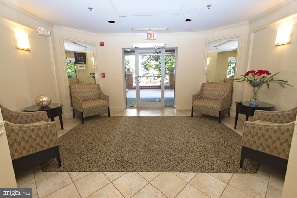 Controlled access lobby w/elevators to all levels - 1855 STRATFORD PARK PL #309, RESTON