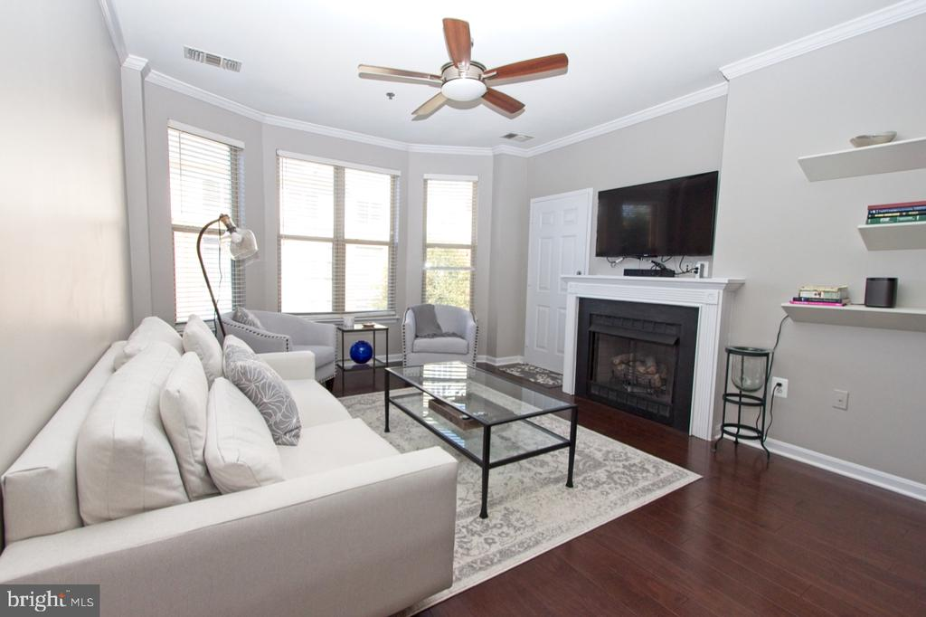 A gas fireplace is ideal for frosty evenings - 1855 STRATFORD PARK PL #309, RESTON
