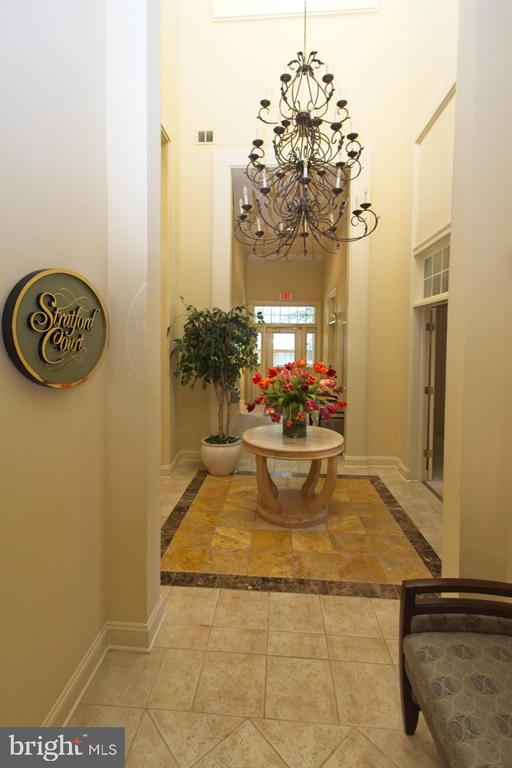 A welcoming Clubhouse entrance - 1855 STRATFORD PARK PL #309, RESTON