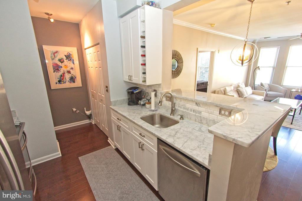 New white cabinetry includes a wine storage space - 1855 STRATFORD PARK PL #309, RESTON