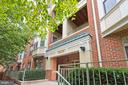 Trees surround the front of your building - 1855 STRATFORD PARK PL #309, RESTON