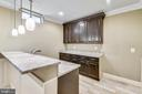 Lower level bar- granite and custom cabinets - 22077 HIGHVIEW TRAIL PL, BROADLANDS