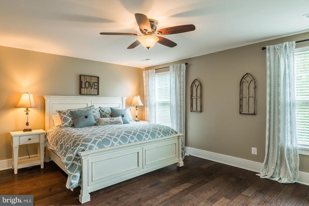 The master bedroom has woods floors - 16960 TAKEAWAY LN, DUMFRIES