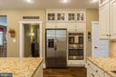 Gourmet kitchen with double ovens - 16960 TAKEAWAY LN, DUMFRIES
