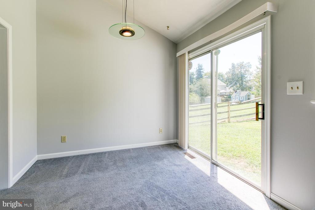 Large dining area opens to back yard - 11604 BEND BOW DR, FREDERICKSBURG