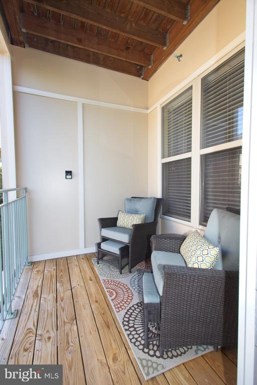 A private balcony accessed from the living room - 1855 STRATFORD PARK PL #309, RESTON