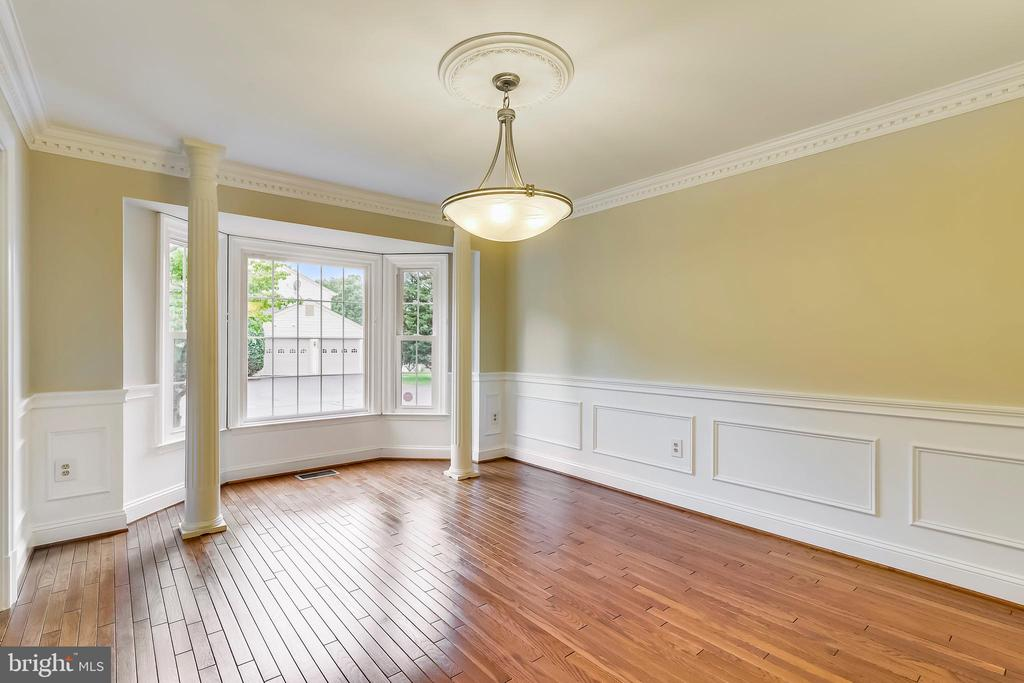 Dining room with upgraded wood trim - 12001 SUGARLAND VALLEY DR, HERNDON