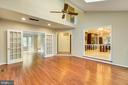 Great room with French doors to the living room - 12001 SUGARLAND VALLEY DR, HERNDON