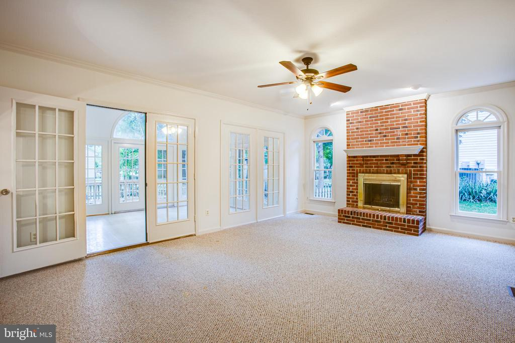 Windows Flank the Family Room Fireplace - 6227 SWEETBRIAR DR, FREDERICKSBURG