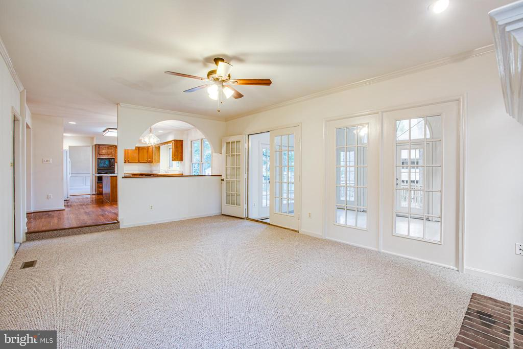 Wall of Windows Separates Family & Sun Room - 6227 SWEETBRIAR DR, FREDERICKSBURG