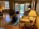 Spacious living room with wood floors - 19375 CYPRESS RIDGE TER #203, LEESBURG