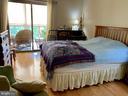 Bedroom 2, wood floors - 19375 CYPRESS RIDGE TER #203, LEESBURG