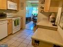 Large kitchen, two entries. - 19375 CYPRESS RIDGE TER #203, LEESBURG