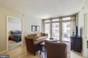Living room with sliding glass doors - 888 N QUINCY ST #909, ARLINGTON