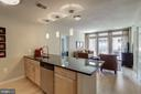 Kitchen breakfast bar with pendant lighting - 888 N QUINCY ST #909, ARLINGTON